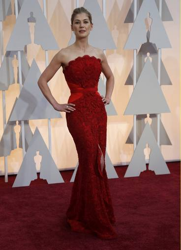 Best actress nominee Pike poses on the red carpet as she arrives at the 87th Academy Awards in Hollywood