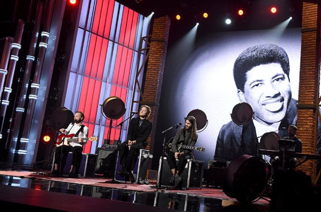 LAS VEGAS, NV - MAY 17:  (L-R) Musicians Ben McKee, Dan Reynolds, Wayne Sermon, and Dan Platzman of Imagine Dragons perform a tribute to late singer Ben E. King (on video screen) onstage during the 2015 Billboard Music Awards at MGM Grand Garden Arena on May 17, 2015 in Las Vegas, Nevada.  (Photo by Kevin Winter/BMA2015/Getty Images for dcp)