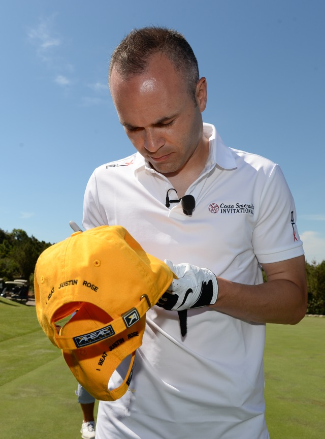OLBIA, SARDINIA - JUNE 27:  Footballer Andres Iniesta of Spain receives a golf lesson from Justin Rose of England during The Costa Smeralda Invitational Golf Tournament at Pevero Golf Club,  Costa Smeralda on June 27, 2015 in Olbia, Italy.  (Photo by Tony Marshall/Getty Images for ProSport) *** Local Caption *** Andres Iniesta; Justin Rose