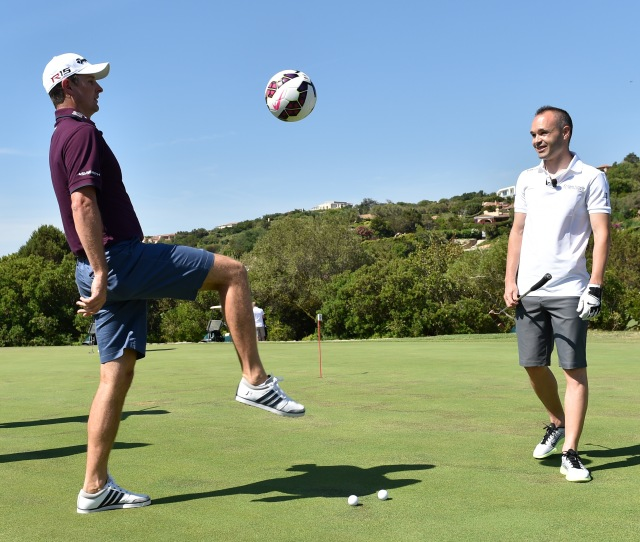 OLBIA, SARDINIA - JUNE 27:  Footballer Andres Iniesta of Spain (R) plays soccer with Justin Rose of England during The Costa Smeralda Invitational Golf Tournament at Pevero Golf Club,  Costa Smeralda on June 27, 2015 in Olbia, Italy.  (Photo by Valerio Pennicino/Getty Images for ProSport) *** Local Caption *** Andres Iniesta; Justin Rose