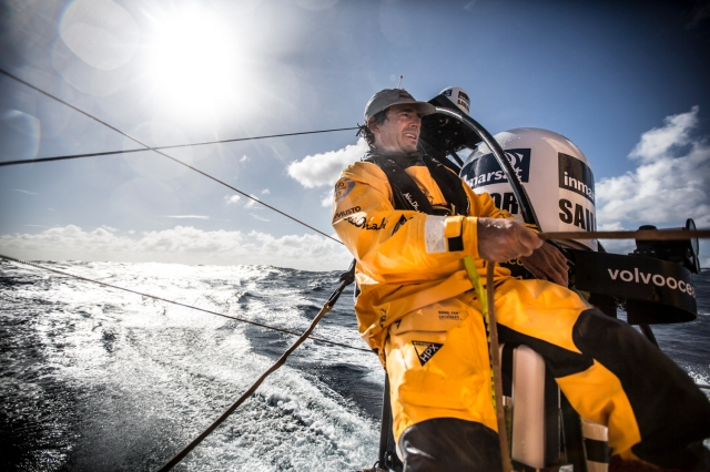 March 19, 2015. Leg 5 to Itajai onboard Abu Dhabi Ocean Racing. Day 01. Roberto Bermudez 'Chuny' sits on the aerial mast trimming the main in the heavy winds of the Southern Ocean.