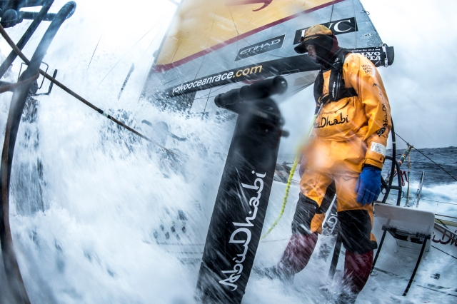 March 28, 2015. Leg 5 to Itajai onboard Abu Dhabi Ocean Racing. Day 11.  Roberto Bermudez, aka Chuny, stops bracing, letting the 3 degree wave simply rush by in the Southern Ocean at sunset.