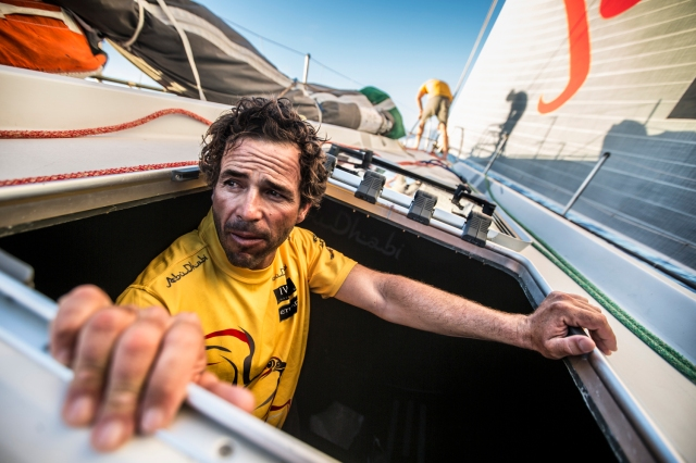 April, 2015. Leg 6 Newport onboard Abu Dhabi Ocean Racing. Day 4.  Roberto Bermudez, aka Chuny, pops his head up from below after stacking the team gear forward in light winds.