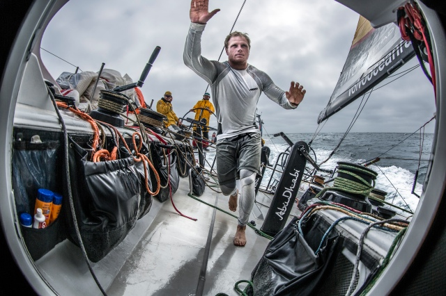 "May 22, 2015. Leg 7 to Lisbon onboard Abu Dhabi Ocean Racing. Day 5.  Luke ""Parko"" Parkinson runs for the hatch before the next wave hits in the Atlantic Ocean."