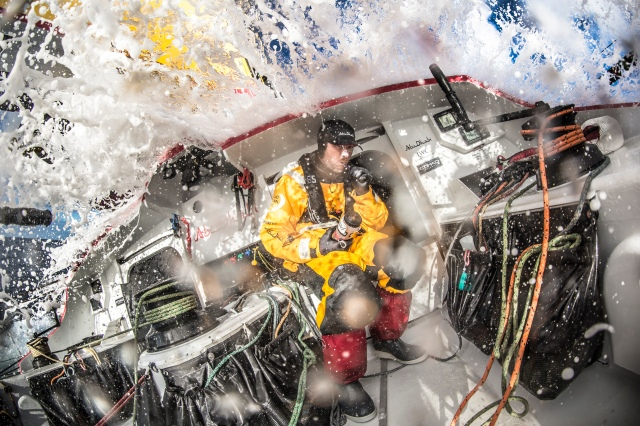 March 23, 2015. Leg 5 to Itajai onboard Abu Dhabi Ocean Racing. Day 05.  Phil Harmer finds space to brush his teeth away from the saltwater.