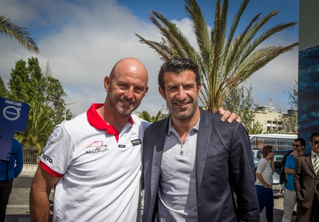 LISBON, PORTUGAL - JUNE 01:  In this handout image provided by the Volvo Ocean Race, portuguese soccer player legend, Luis Figo, visits de the Volvo Ocean Race Village in Lisbon on behalf the Luis Figo Foundation for International Children's Day with Abu Dhabi Ocean Racing Skipper Ian Walker during the stopover ahead of Leg 8 from Lisbon to L'Orient on May 25, 2015 in Lisbon, Portugal. The Volvo Ocean Race 2014-15 is the 12th running of this ocean marathon. Starting from Alicante in Spain on October 04, 2014, the route, spanning some 39,379 nautical miles, visits 11 ports in eleven countries (Spain, South Africa, United Arab Emirates, China, New Zealand, Brazil, United States, Portugal, France, The Netherlands and Sweden) over nine months. The Volvo Ocean Race is the world's premier ocean yacht race for professional racing crews. (Photo by Ainhoa Sanchez / Volvo Ocean Race via Getty Images)