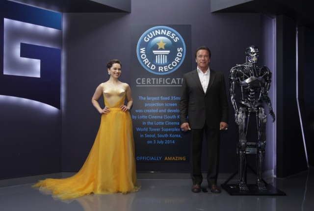 SEOUL, SOUTH KOREA - JULY 02:  Emilia Clarke and Arnold Schwarzenegger pose in front of the sign a listed in the Guinness book of records as largest theater screen in the world during the Seoul Premiere of 'Terminator Genisys' at the Lotte World Tower Mall on July 2, 2015 in Seoul, South Korea.  (Photo by Chung Sung-Jun/Getty Images for Paramount Pictures International) *** Local Caption *** Emilia Clarke; Arnold Schwarzenegger