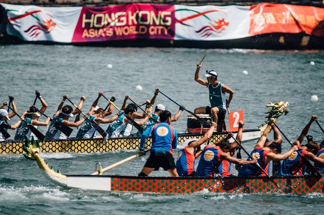 HONG KONG - JULY 05:  Competitors paddle their boats during the Hong Kong Dragon Boat Carnival Race on July 5, 2015 in Hong Kong, Hong Kong. The Hong Kong Dragon Boat Carnival will be staged from 3 July 2015 (Friday) to 5 July 2015 (Sunday). The carnival featured two key programmes: the CCB (Asia) Hong Kong International Dragon Boat Races in Victoria Harbour and the San Miguel BeerFest at the UC Centenary Garden in East Tsim Sha Tsui.  (Photo by Anthony Kwan/Getty Images for Hong Kong Images)