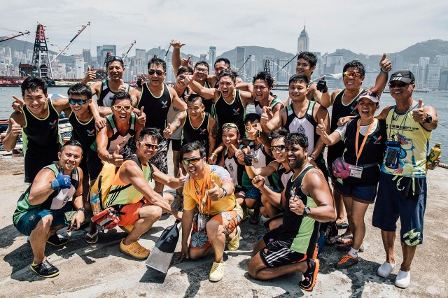 HONG KONG - JULY 05:  Competitors pose for pictures after their race at the Hong Kong Dragon Boat Carnival Race on July 5, 2015 in Hong Kong, Hong Kong. The Hong Kong Dragon Boat Carnival will be staged from 3 July 2015 (Friday) to 5 July 2015 (Sunday). The carnival featured two key programmes: the CCB (Asia) Hong Kong International Dragon Boat Races in Victoria Harbour and the San Miguel BeerFest at the UC Centenary Garden in East Tsim Sha Tsui.  (Photo by Anthony Kwan/Getty Images for Hong Kong Images)