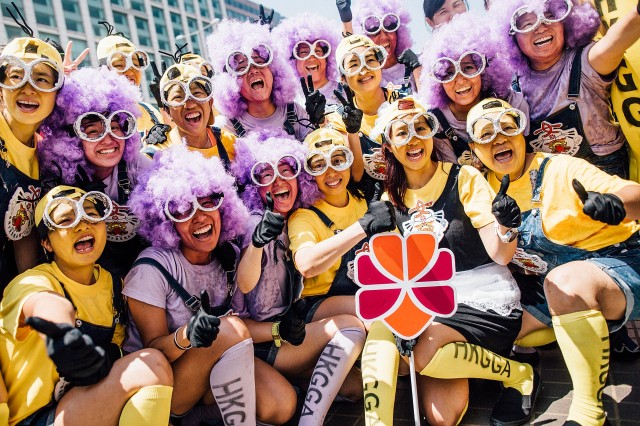 HONG KONG - JULY 05:  Competitors dressing in costumes celebrelate after the Hong Kong Airlines Fancy Dress Race at the Hong Kong Dragon Boat Carnival Race on July 5, 2015 in Hong Kong, Hong Kong. The Hong Kong Dragon Boat Carnival will be staged from 3 July 2015 (Friday) to 5 July 2015 (Sunday). The carnival featured two key programmes: the CCB (Asia) Hong Kong International Dragon Boat Races in Victoria Harbour and the San Miguel BeerFest at the UC Centenary Garden in East Tsim Sha Tsui.  (Photo by Anthony Kwan/Getty Images for Hong Kong Images)