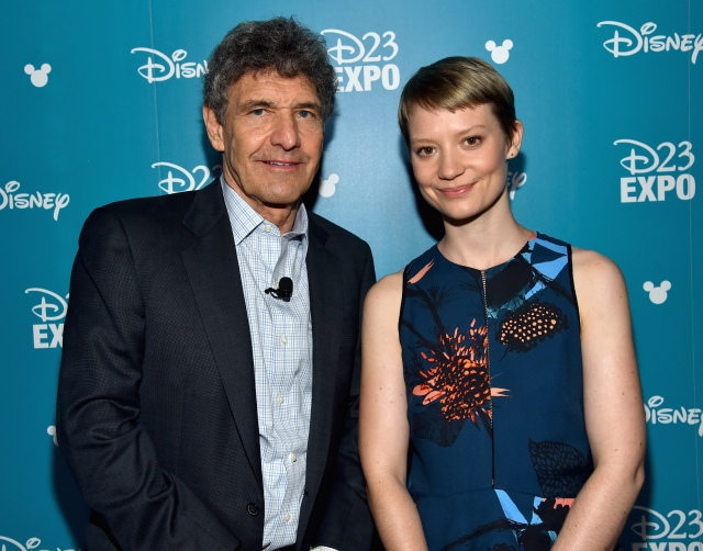 "ANAHEIM, CA - AUGUST 15: Chairman of the Walt Disney Studios Alan Horn (L) and actress Mia Wasikowska of ALICE THROUGH THE LOOKING GLASS took part today in ""Worlds, Galaxies, and Universes: Live Action at The Walt Disney Studios"" presentation at Disney's D23 EXPO 2015 in Anaheim, Calif. ALICE THROUGH THE LOOKING GLASS will be released in U.S. theaters on May 27, 2016. (Photo by Alberto E. Rodriguez/Getty Images for Disney) *** Local Caption *** Alan Horn; Mia Wasikowska"