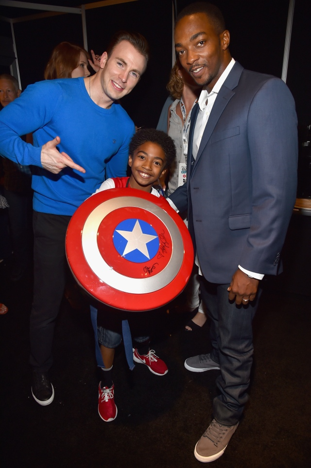 "ANAHEIM, CA - AUGUST 15: (L-R) Actor Chris Evans of CAPTAIN AMERICA: CIVIL WAR, actor Miles Brown and actor Anthony Mackie of CAPTAIN AMERICA: CIVIL WAR took part today in ""Worlds, Galaxies, and Universes: Live Action at The Walt Disney Studios"" presentation at Disney's D23 EXPO 2015 in Anaheim, Calif. (Photo by Alberto E. Rodriguez/Getty Images for Disney) *** Local Caption *** Chris Evans; Miles Brown; Anthony Mackie"