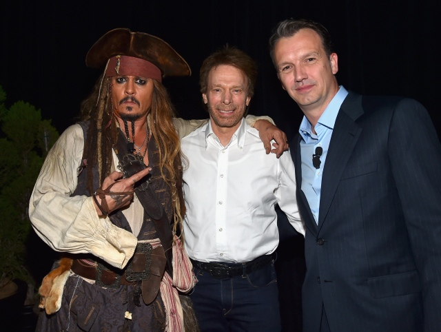 "ANAHEIM, CA - AUGUST 15:  (L-R) Actor Johnny Depp, dressed as Captain Jack Sparrow and producer Jerry Bruckheimer of PIRATES OF THE CARIBBEAN: DEAD MEN TELL NO TALES with President of Walt Disney Studios Motion Picture Production Sean Bailey took part today in ""Worlds, Galaxies, and Universes: Live Action at The Walt Disney Studios"" presentation at Disney's D23 EXPO 2015 in Anaheim, Calif.  (Photo by Alberto E. Rodriguez/Getty Images for Disney) *** Local Caption *** Johnny Depp; Sean Bailey; Jerry Bruckheimer"