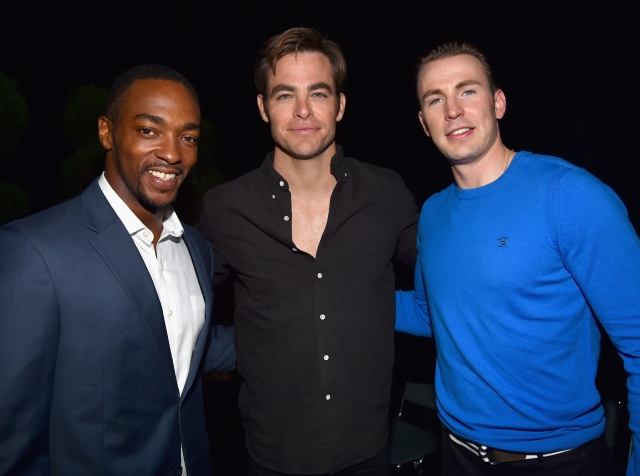 "ANAHEIM, CA - AUGUST 15: Actors Anthony Mackie (L) and Chris Evans (R) of CAPTAIN AMERICA: CIVIL WAR and Chris Pine of THE FINEST HOURS (C) took part today in ""Worlds, Galaxies, and Universes: Live Action at The Walt Disney Studios"" presentation at Disney's D23 EXPO 2015 in Anaheim, Calif. (Photo by Alberto E. Rodriguez/Getty Images for Disney) *** Local Caption *** Anthony Mackie; Chris Evans; Chris Pine"