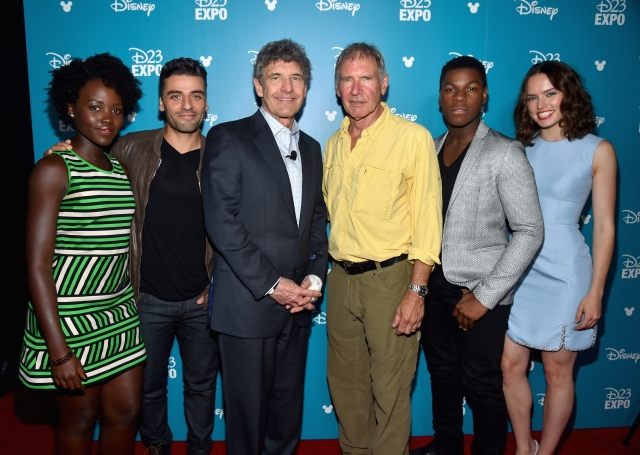 "ANAHEIM, CA - AUGUST 15: (L-R) Actors Lupita Nyong'o, Oscar Isaac, Chairman of the Walt Disney Studios Alan Horn, actors Harrison Ford, John Boyega and Daisy Ridley of STAR WARS: THE FORCE AWAKENS took part today in ""Worlds, Galaxies, and Universes: Live Action at The Walt Disney Studios"" presentation at Disney's D23 EXPO 2015 in Anaheim, Calif.  (Photo by Alberto E. Rodriguez/Getty Images for Disney) *** Local Caption *** Lupita Nyong'o; Oscar Isaac; Alan Horn; Harrison Ford; John Boyega; Daisy Ridley"