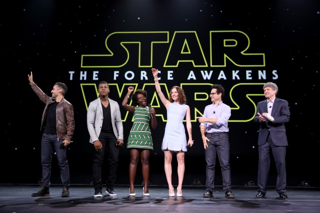 "ANAHEIM, CA - AUGUST 15:  (L-R) Actors Oscar Isaac, John Boyega, Lupita Nyong'o, Daisy Ridley, director J.J. Abrams of STAR WARS: THE FORCE AWAKENS and Chairman of the Walt Disney Studios Alan Horn took part today in ""Worlds, Galaxies, and Universes: Live Action at The Walt Disney Studios"" presentation at Disney's D23 EXPO 2015 in Anaheim, Calif.  (Photo by Jesse Grant/Getty Images for Disney) *** Local Caption *** Oscar Isaac; John Boyega; Lupita Nyong'o; Daisy Ridley; J.J. Abrams; Alan Horn"