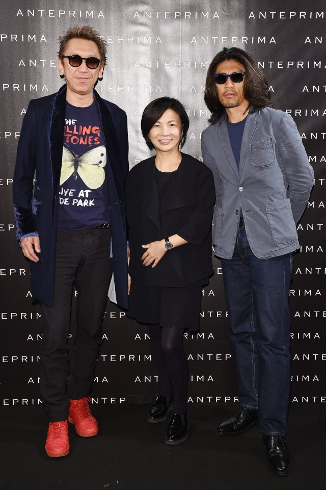 MILAN, ITALY - SEPTEMBER 24:   Tomoyasu Hotei, Designer Izumi Ogino and Tsuchida Yasuhiko i pose backstage ahead backstage ahead of the Anteprima show during Milan Fashion Week Spring/Summer 2016  on September 24, 2015 in Milan, Italy.  (Photo by Venturelli/Getty Images for Anteprima) *** Local Caption *** Tomoyasu Hotei; Izumi Ogino; Izumi Ogino