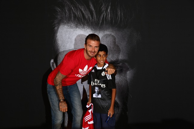 DUBAI, UNITED ARAB EMIRATES - SEPTEMBER 29:  Global icon and footballing legend David Beckham greets 11 year old Ayaan Nadeem at the opening of the new adidas HomeCourt concept store in the Mall of Emirates, Dubai. Thousands of fans turned up to catch a glimpse of the sporting superstar during a whistle-stop visit to the United Arab Emirates on September 29, 2015 in Dubai, United Arab Emirates.  (Photo by Warren Little/Getty Images) *** Local Caption *** David Beckham