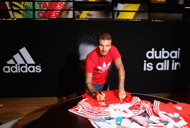 DUBAI, UNITED ARAB EMIRATES - SEPTEMBER 29:  Global icon and footballing legend David Beckham signs autographs today as he opened the new adidas HomeCourt concept store in the Mall of Emirates, Dubai to the delight of thousands of fans who caught a glimpse of the sporting superstar during a whistle-stop visit to the United Arab Emirates on September 29, 2015 in Dubai, United Arab Emirates.  (Photo by Warren Little/Getty Images) *** Local Caption *** David Beckham