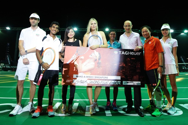 SINGAPORE - OCTOBER 22: Shaheed Alam (2nd L), Elaine Tan (3rd L), Maria Sharapova (4th L), Angeline Devi Devanthiran (5th L), Luc Decroix (3rd R), and Michael Chang (2nd R) pose for a photo after Luc Decroix, VP of Global Sales TAG Heuer presents a cheque to Elaine Tan, Director of Development from Make-A-Wish Foundation during the Maria Sharapova Exhibition Match at Clifford Pier, Fullerton Bay Hotel on October 22, 2015 in Singapore. (Photo by Suhaimi Abdullah/Getty Images For TAG Heuer) *** Local Caption *** Shaheed Alam; Elaine Tan; Maria Sharapova; Angeline Devi Devanthiran; Luc Decroix; Michael Chang