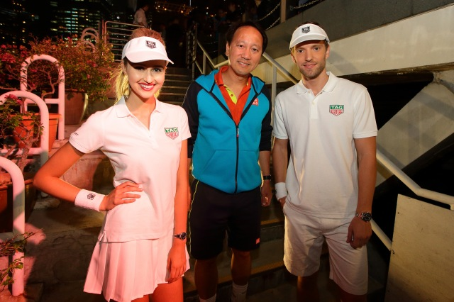 SINGAPORE - OCTOBER 22: Michael Chang (C) poses for a photo with the models during the Maria Sharapova Exhibition Match at Clifford Pier, Fullerton Bay Hotel on October 22, 2015 in Singapore. (Photo by Suhaimi Abdullah/Getty Images For TAG Heuer) *** Local Caption *** Michael Chang