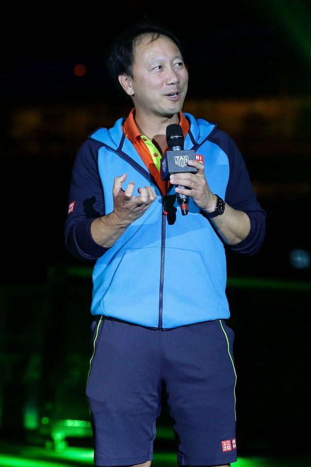 SINGAPORE - OCTOBER 22: Michael Chang speaks on court during the Maria Sharapova Exhibition Match at Clifford Pier, Fullerton Bay Hotel on October 22, 2015 in Singapore. (Photo by Suhaimi Abdullah/Getty Images For TAG Heuer) *** Local Caption *** Michael Chang