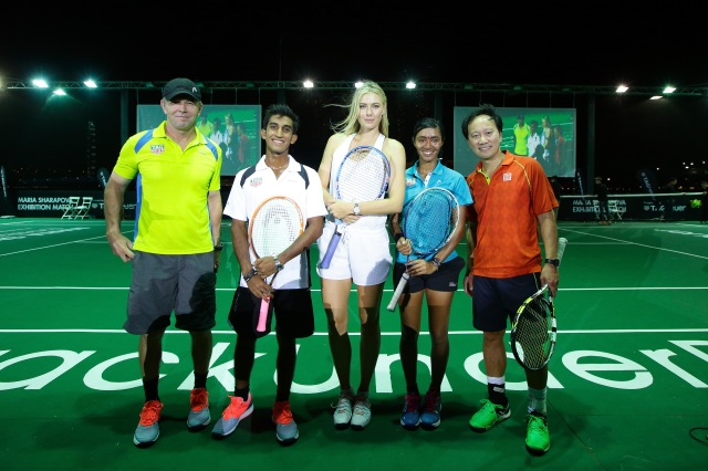 SINGAPORE - OCTOBER 22: (L-R) Michael Baroach, Shaheed Alam, Maria Sharapova, Angeline Devi Devanthiran and Michael Chang pose for a photo during the Maria Sharapova Exhibition Match at Clifford Pier, Fullerton Bay Hotel on October 22, 2015 in Singapore. (Photo by Suhaimi Abdullah/Getty Images For TAG Heuer) *** Local Caption *** Michael Baroach; Shaheed Alam Maria Sharapova; Angeline Devi Devanthiran; Michael Chang