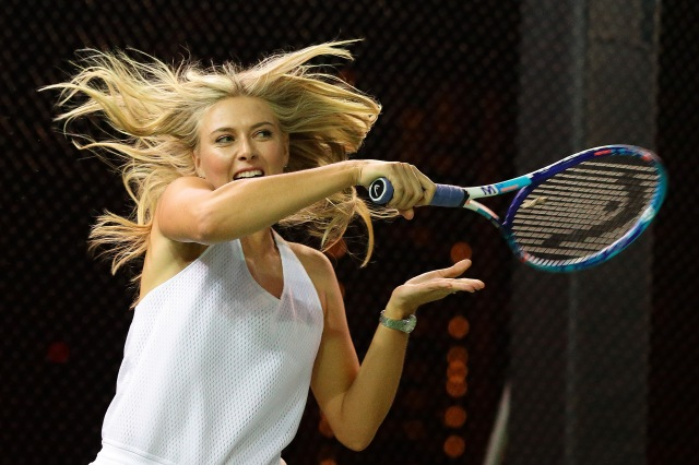 SINGAPORE - OCTOBER 22: Maria Sharapova in action during the Maria Sharapova Exhibition Match at Clifford Pier, Fullerton Bay Hotel on October 22, 2015 in Singapore. (Photo by Suhaimi Abdullah/Getty Images For TAG Heuer) *** Local Caption *** Maria Sharapova