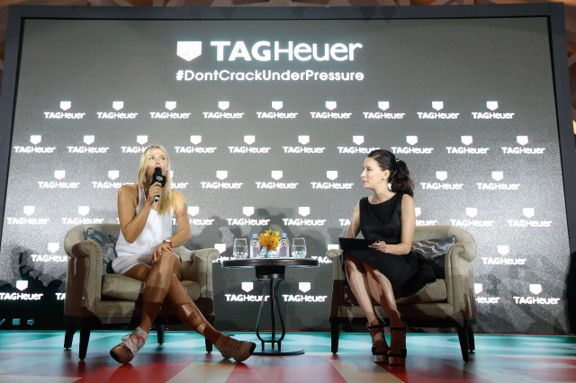 SINGAPORE - OCTOBER 22: Maria Sharapova (L) speaks on stage during the Maria Sharapova Exhibition Match at Clifford Pier, Fullerton Bay Hotel on October 22, 2015 in Singapore. (Photo by Suhaimi Abdullah/Getty Images For TAG Heuer) *** Local Caption *** Maria Sharapova