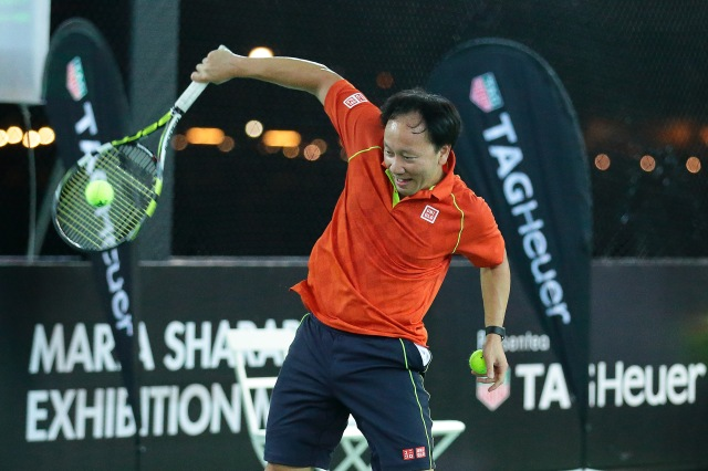 SINGAPORE - OCTOBER 22: Michael Chang in action during the Maria Sharapova Exhibition Match at Clifford Pier, Fullerton Bay Hotel on October 22, 2015 in Singapore. (Photo by Suhaimi Abdullah/Getty Images For TAG Heuer) *** Local Caption *** Michael Chang