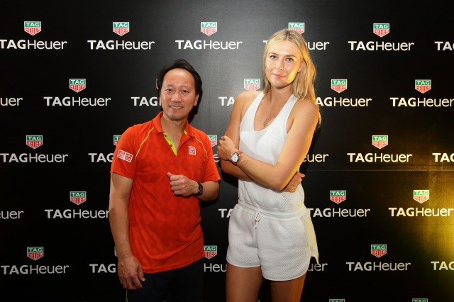 SINGAPORE - OCTOBER 22: Maria Sharapova (R) and Michael Chang (L) pose for a photo during the Maria Sharapova Exhibition Match at Clifford Pier, Fullerton Bay Hotel on October 22, 2015 in Singapore. (Photo by Suhaimi Abdullah/Getty Images For TAG Heuer) *** Local Caption *** Maria Sharapova; Michael Chang