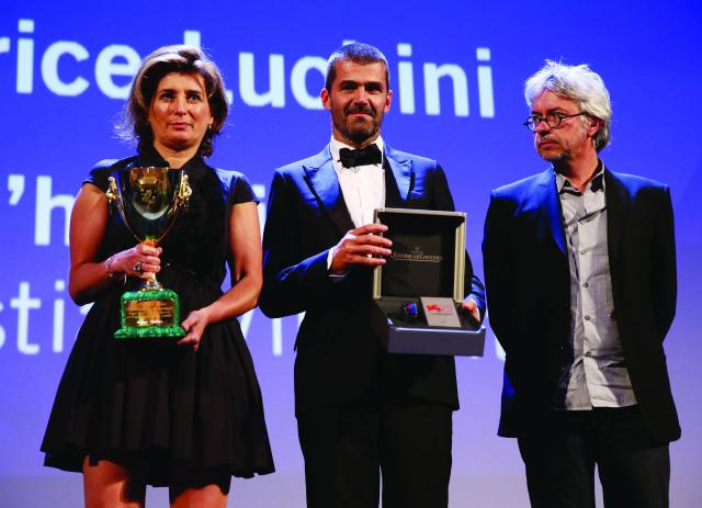 on stage with the XXXXX award at the closing ceremony during the 72nd Venice Film Festival on September 12, 2015 in Venice, Italy.