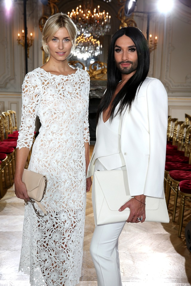 PARIS, FRANCE - OCTOBER 04:  Lena Gercke and Conchita Wurst attend the Kaviar Gauche show as part of the Paris Fashion Week Womenswear Spring/Summer 2016 at Salon France-Ameriques on October 4, 2015 in Paris, France.  (Photo by Pierre Suu/Getty Images for Kaviar Gauche) *** Local Caption *** Lena Gercke; Conchita Wurst