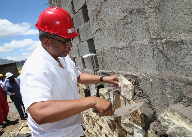 MASERU, LESOTHO - DECEMBER 10: Prince Seeiso of Lesotho helps with sandstone cladding for the guardhouse as he visits the construction site for the new Sentebale Mamohato Children's Centre at Thaba-Bosiu on December 10, 2014 in Maseru, Lesotho. Prince Harry was visiting Lesotho to see the work of his charity Sentebale. Sentebale provides healthcare and education to vulnerable children in Lesotho, Southern Africa. The particular theme of his visit was to check on the progress of the Mamohato Children's Centre which will provide vital support to children affected by HIV. Prince Harry founded Sentebale (which means 'Forget Me Not' in Sesotho) with Prince Seeiso in 2006. (Photo by Chris Jackson/Getty Images) *** Local Caption *** Prince Seeiso of Lesotho