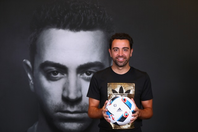 DUBAI, UNITED ARAB EMIRATES - NOVEMBER 23:  Spanish football legend Xavi opens adidas zone in the new flagship Go-Sports Store in the Mall of Emirates Dubai. One of the greatest footballers of all time met with adidas competition winners and showcased his talents in adidas skills cage on November 23, 2015 in Dubai, United Arab Emirates.  (Photo by Francois Nel/Getty Images for adidas)