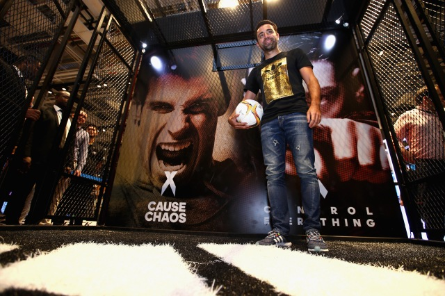 DUBAI, UNITED ARAB EMIRATES - NOVEMBER 23:  Spanish football legend Xavi opens adidas zone in the new flagship Go-Sports Store in the Mall of Emirates Dubai. One of the greatest footballers of all time met with adidas competition winners and showcased his talents in adidas skills cage on November 23, 2015 in Dubai, United Arab Emirates.  (Photo by Francois Nel/Getty Images for adidas) *** Local Caption *** Xavi